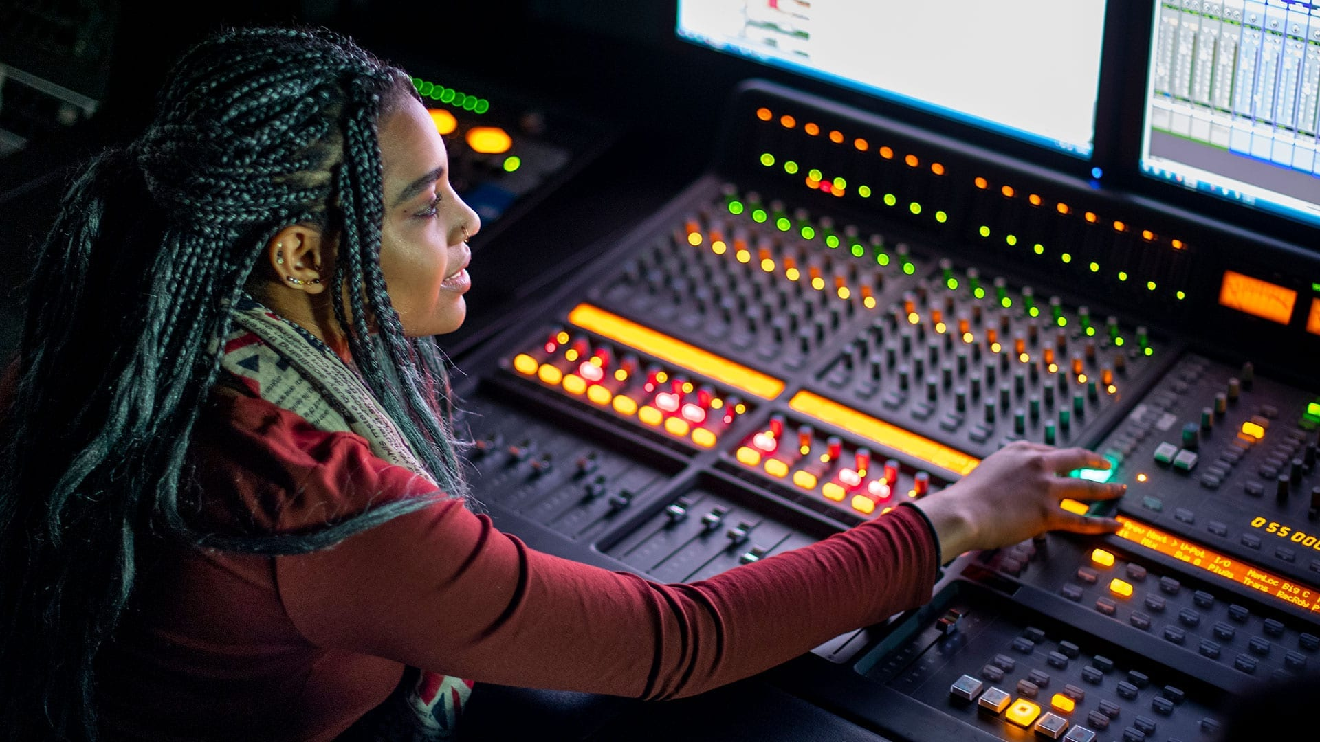 Student working at sound board